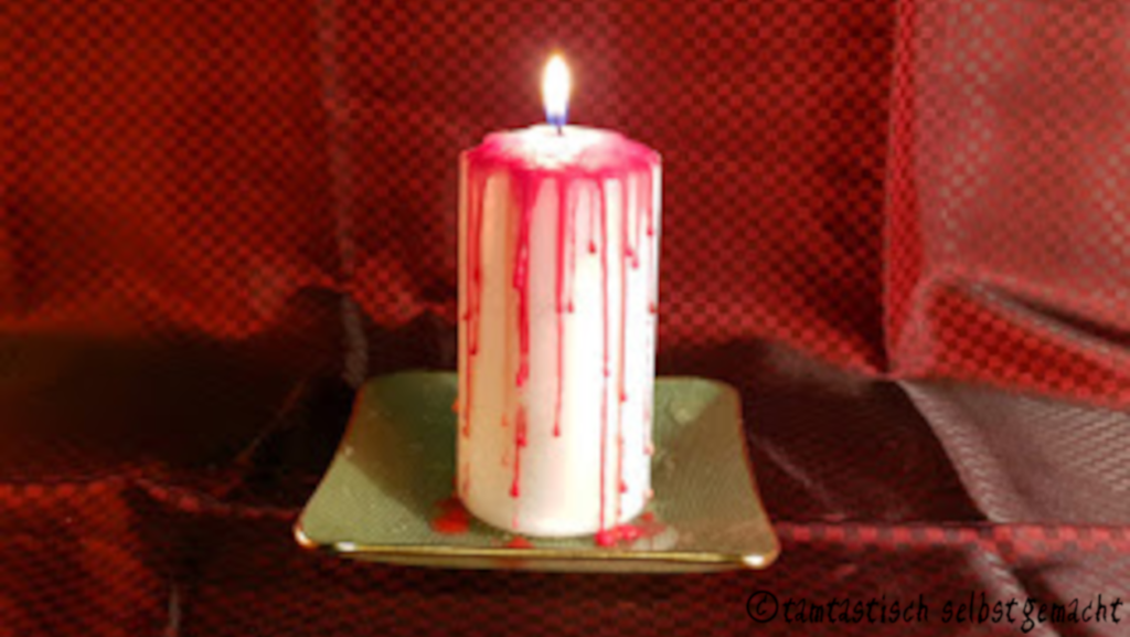 angezündete blutende Kerze
